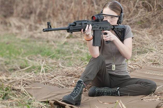 Teen shooter with a hydraulically-dampened  .308