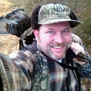 A happy hunter with a well-earned gobbler. Photo © Russ Chastain