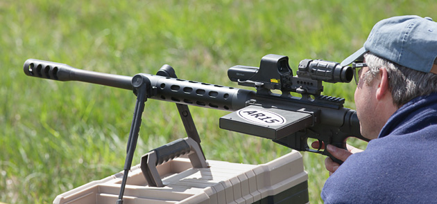 EOTech sight used ith 3x magnifier on a bolt action 50BMG AR upper.