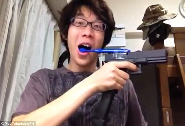 Boy Brushes Teeth with his Airsoft Gun