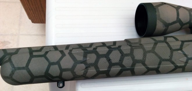 Forearm and front of scope of painted 17 HMR rifle