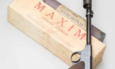 1920s Maxim silencer next to its mailing tube. It retailed for about $3 and could be shipped directly to the purchaser by mail.