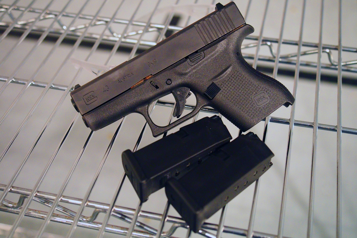 A Glock 43 with a couple magazines.