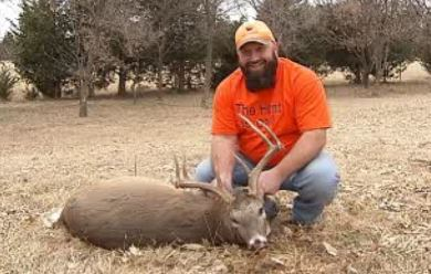 Chuck Rorie with antlered doe