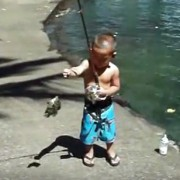 A young fisherman with his catch