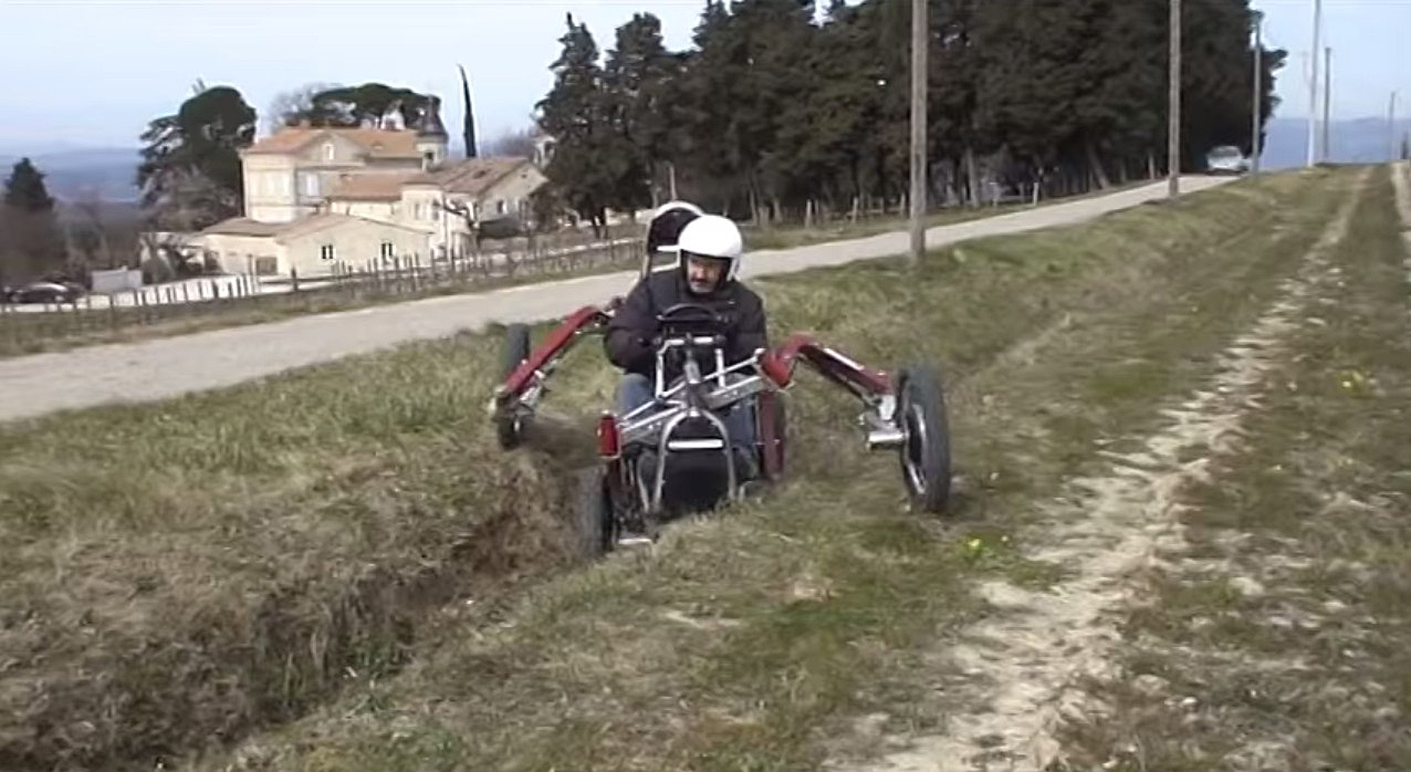 Swincar Electric Articulated ATV crossing a ditch