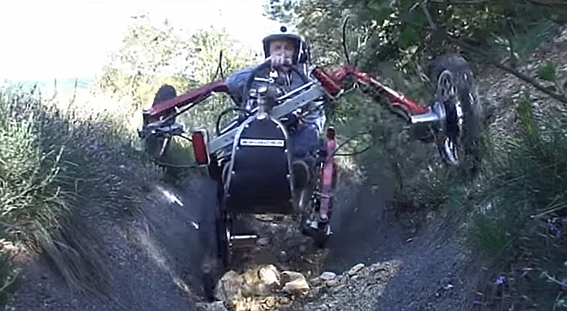 Swincar Electric Articulated ATV in a deep ditch