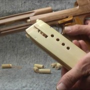 Wooden Desert Eagle pistol with working mag and cartridges.