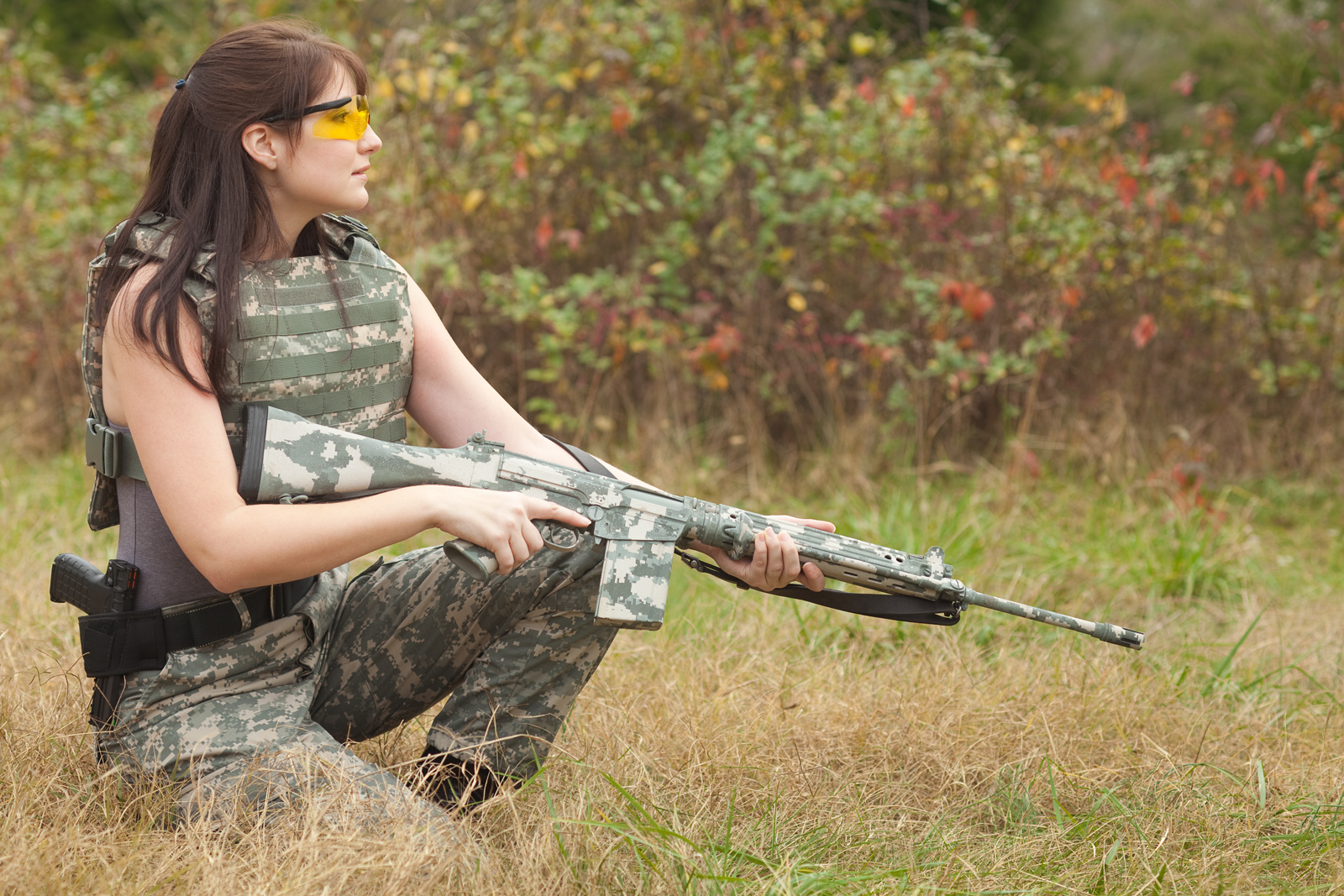 Camouflage Patterns on Guns: to Hide or to Flaunt?