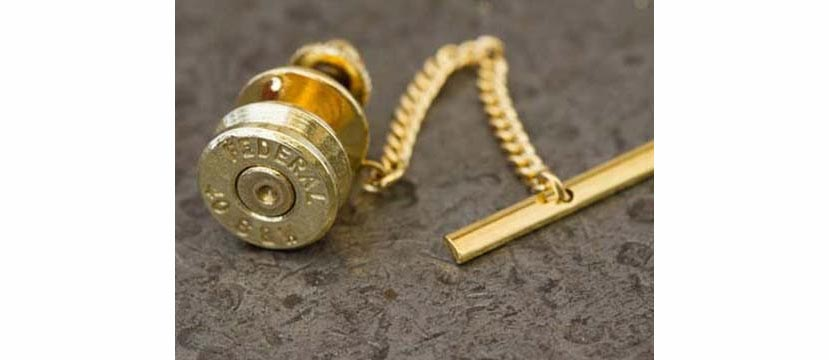 Case head tie tack, choose from 10 different cartridges in brass or nickel. (Photo: Ammo Wear)