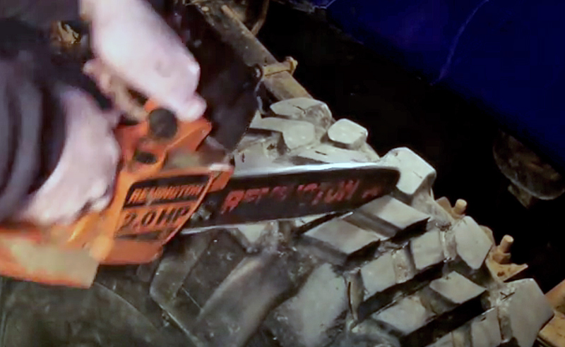 Watch: Redneck + Chainsaw = New Tire Treads