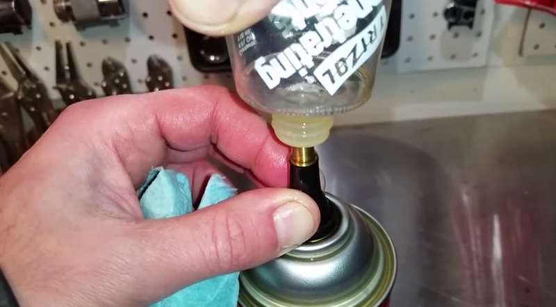 Watch: How to Refill an Aerosol Can With Oil and Pressurize it