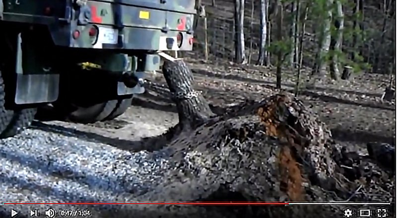 Watch: Pulling a Tree Stump With a 5-Ton Military Truck