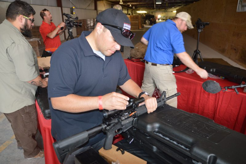 A Springfield Armory rep tightens down the scope on a rifle.