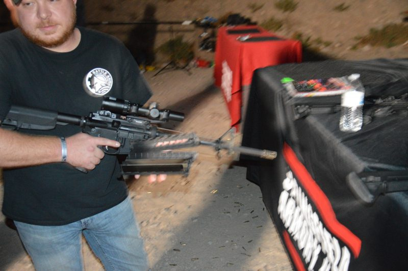 Patrick R. with his melted off handguards. Note the color change on the flash hider from burning off the finish.
