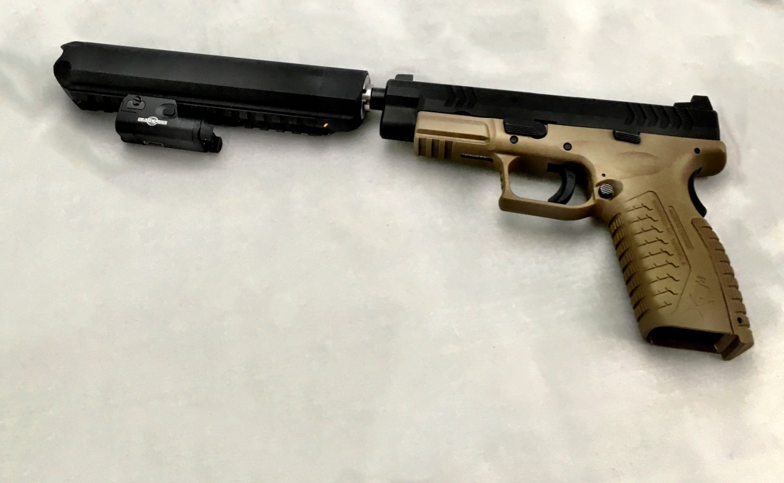 Review: the Alpha Dog 9 Suppressor with Picatinny Rail
