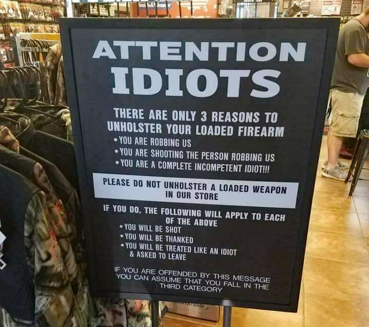 Sign Reminds Customers to Keep it in their Pants (or Holster)