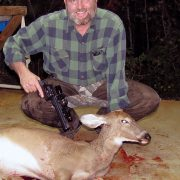 Posing with the Danjo Doe, the first critter bagged using Dad's old Dan Wesson 44 revolver. (Photo: Russ Chastain)