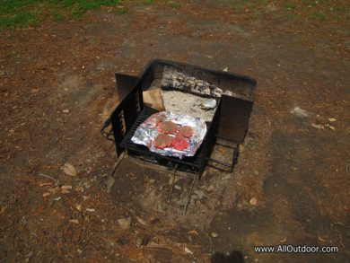 Cooking burgers on a fire ring