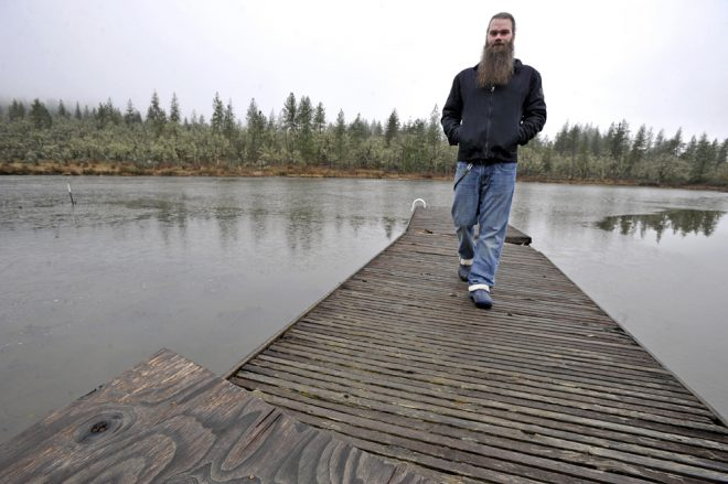 "Jon Carey and his ""illegal"" pond. (Photo: Mail Tribune / Jamie Lusch)"