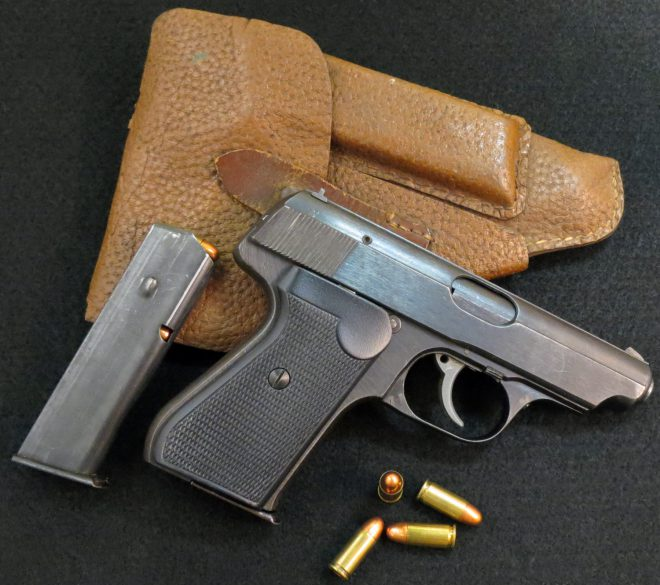 J.P. Sauer 38H pistol with spare mag, four rounds of ammo, and (probably original) fake-leather holster. (Photo © Russ Chastain)