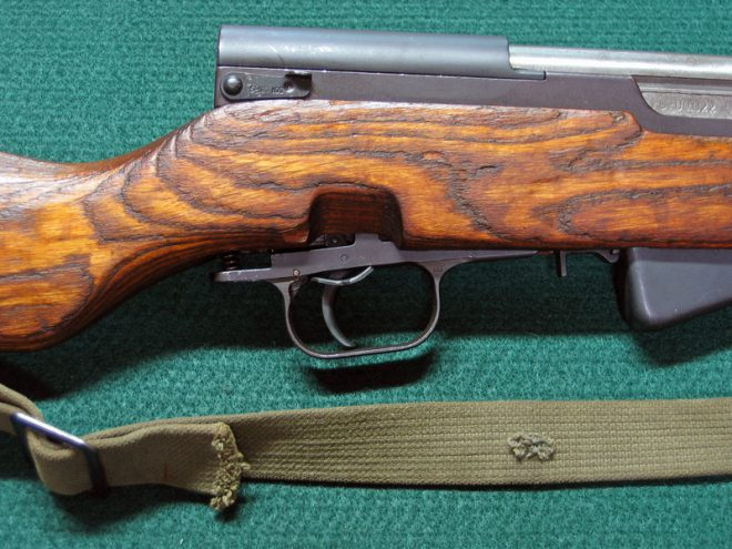Removing SKS trigger group. (Photo © Russ Chastain)