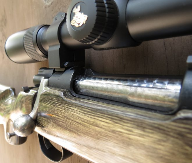 The jeweled bolt is a nice touch and the bolt handle is just about perfect. Note the finish already wearing off the rear of the receiver cutout. (Photo © Russ Chastain)