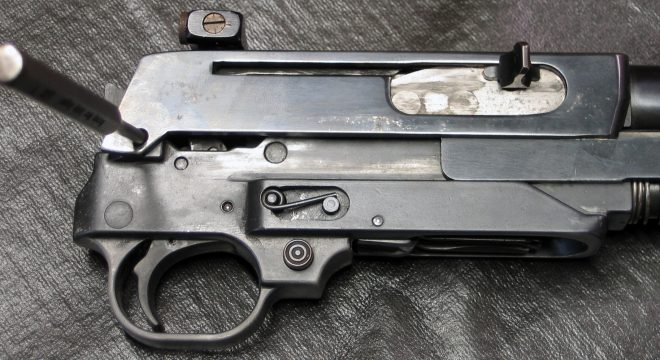 Removing the trigger assembly from a Ruger 44 carbine. (Photo © Russ Chastain)
