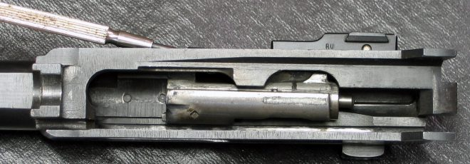 Remove the bolt from a Ruger 44 carbine. (Photo © Russ Chastain)