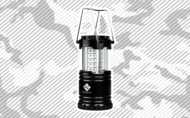Etekcity LED camping lantern on urban camo background