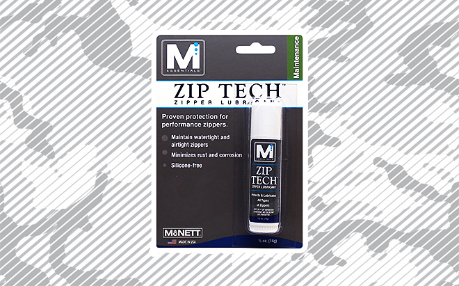 McNett Zip Tech zipper lubricant on urban camo background