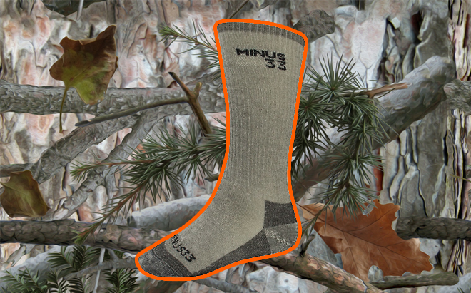 Minus33 Expedition Mountaineering merino wool sock on realistic 3D forest camo background