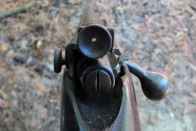 The peep sight on an old 22 rifle. The large surface area helps keep your eye focused on the front sight. Photo © Russ Chastain