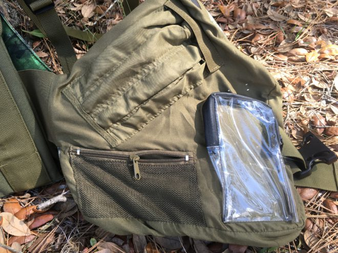 Inside left. Striker pockets, mesh pocket, waterproof phone pocket. (Photo © Russ Chastain)