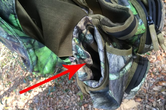 Arrow indicates the right handwarmer pocket. They are deep and fleecy and snug. (Photo © Russ Chastain)