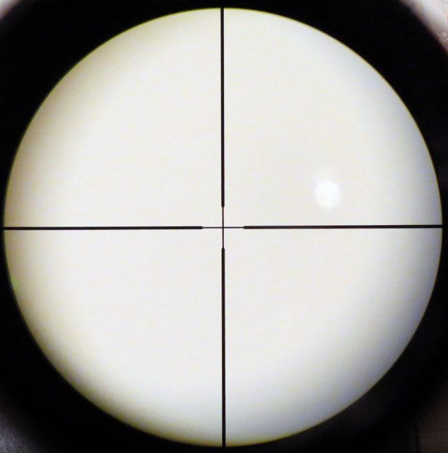 A simple duplex crosshair reticle in a conventional scope. Aiming point is right in the center. Photo © Russ Chastain