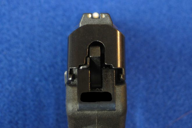 This pistol has three-dot sights, almost properly aligned (front sight is a bit too far left). The front sight's white dot is not as large as it appears here. Usually, the bullet should strike at the top edge of the front sight. Photo © Russ Chastain