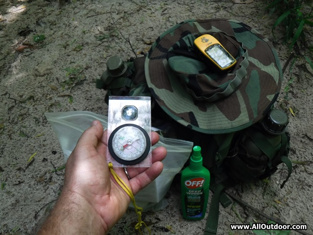 Compass, backpack, boonie hat and GPS