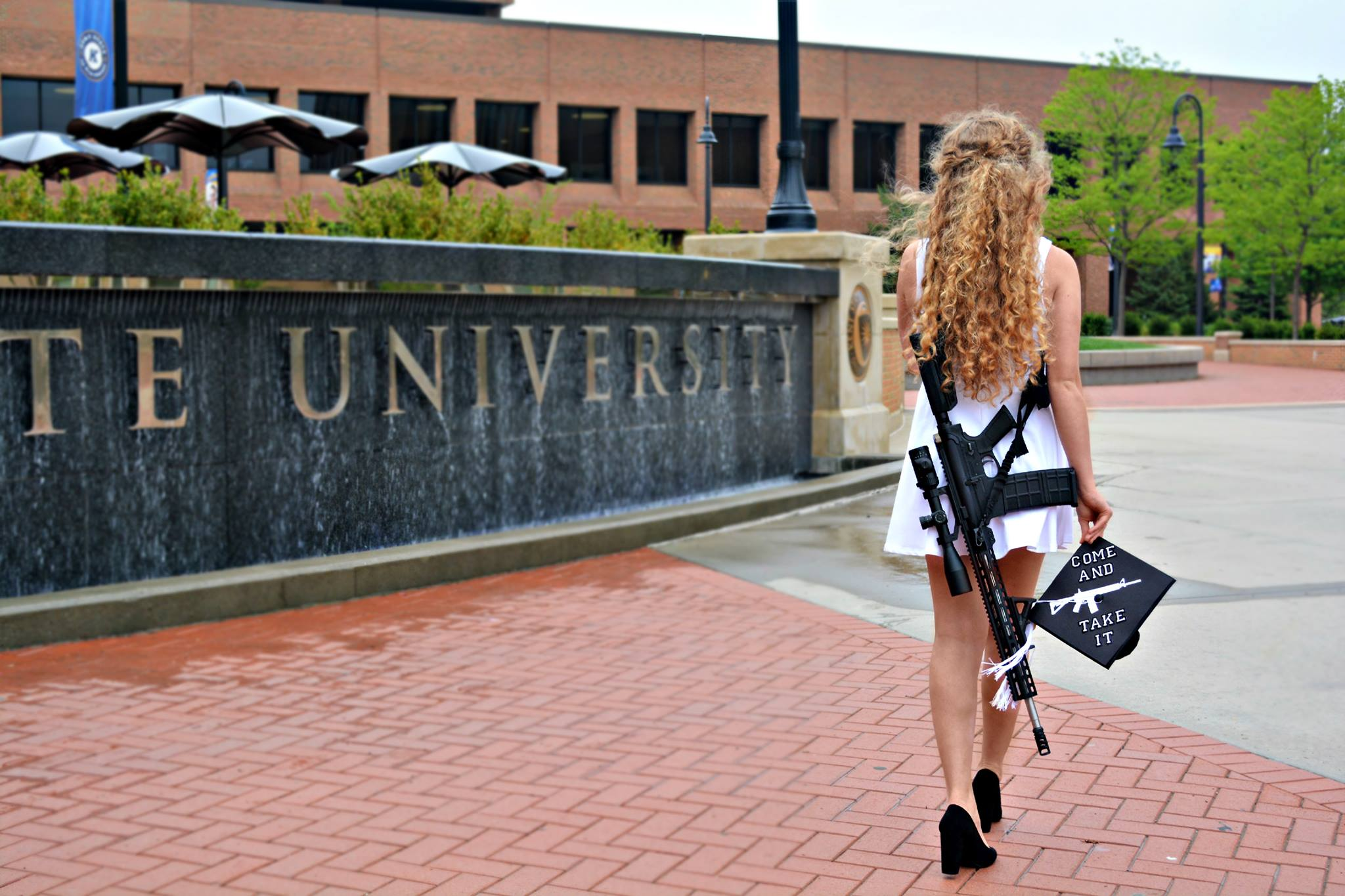 Her Graduation Photos Brought Death Threats — Because She Had a Gun