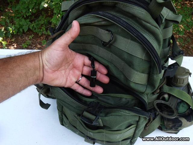 Olight i1R EOS on a backpack