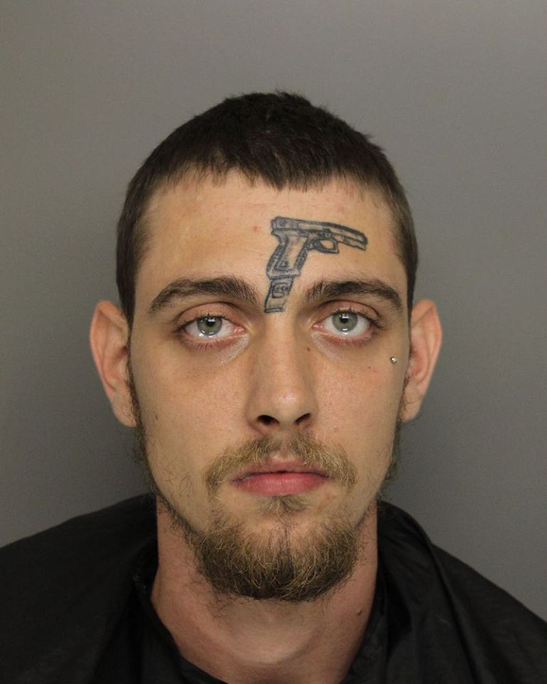 Guy With Gun Tattoo Charged With Illegal Firearm Possession