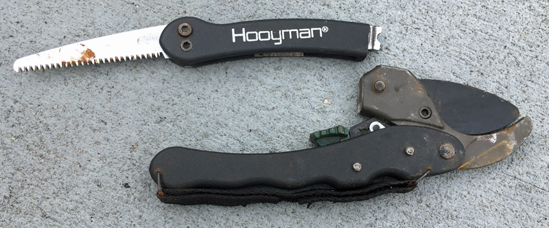 Hooyman Ratchet Pruner with saw open and detached.