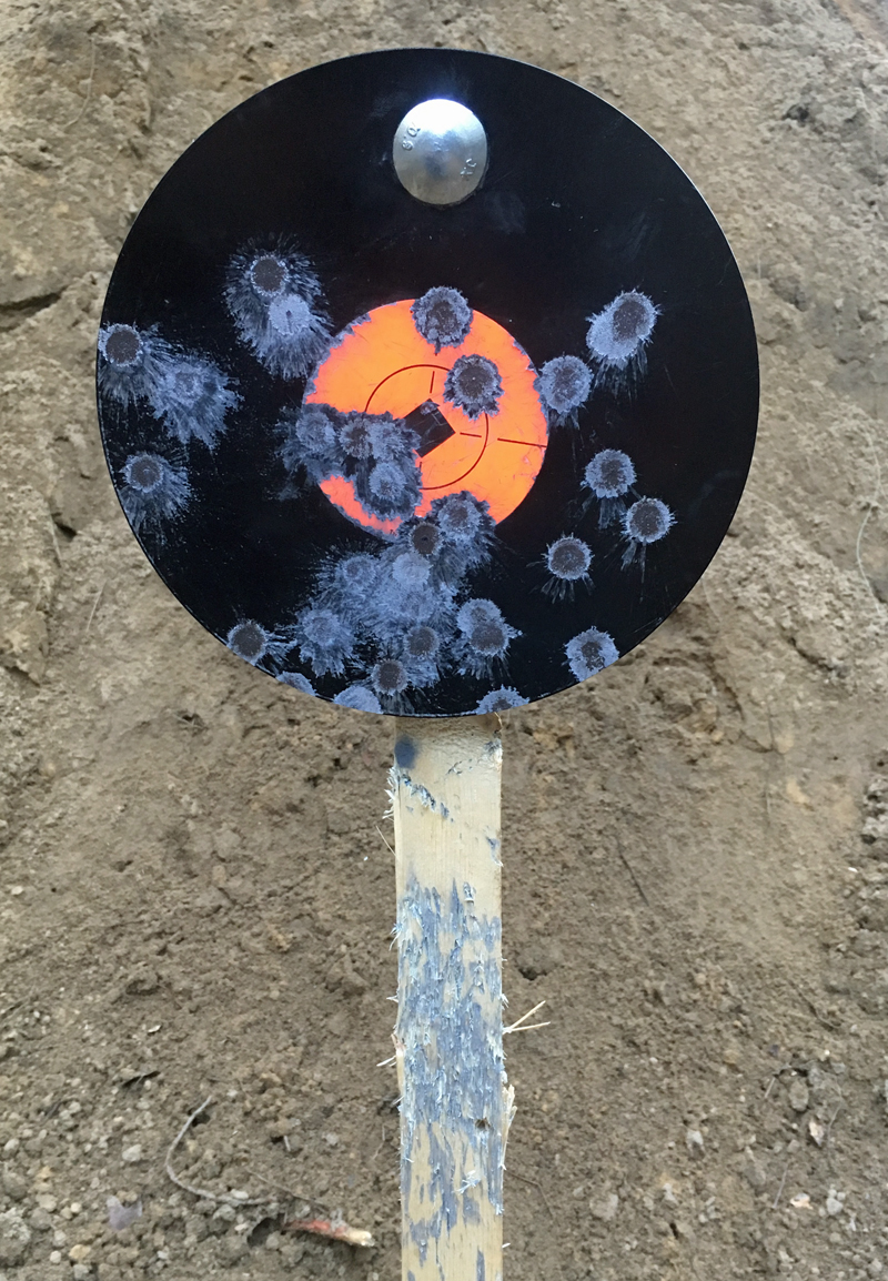 "Birchwood Casey 8"" Round 3/8"" AR500 Steel Gong after several shots."