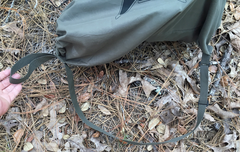 The shoulder strap is adjustable and the small loop helps when stowing the decoy.