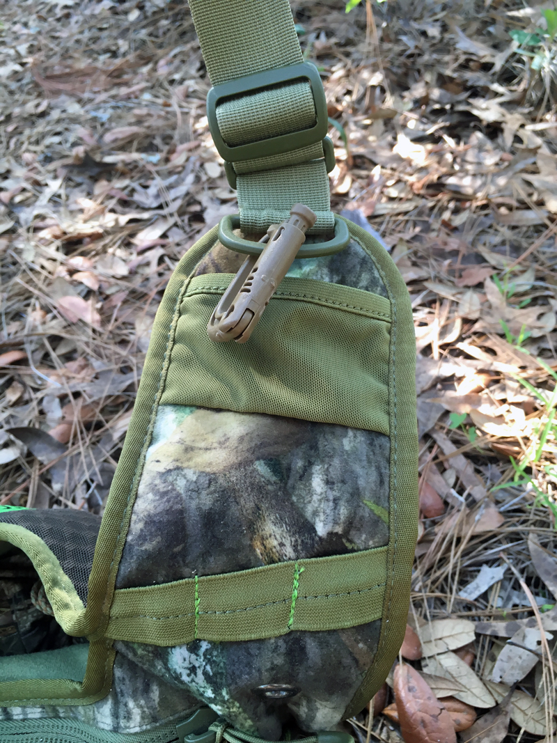Avian-X Rundown Sling Pack strap pockets. Don't trust the mesh pockets! I added the brown carabiner clip.