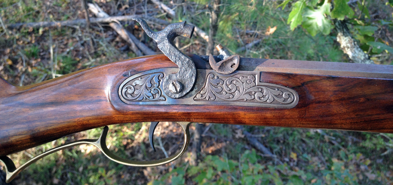 An old-fashioned traditional muzzleloader has the cap exposed to the elements. (Photo © Russ Chastain)