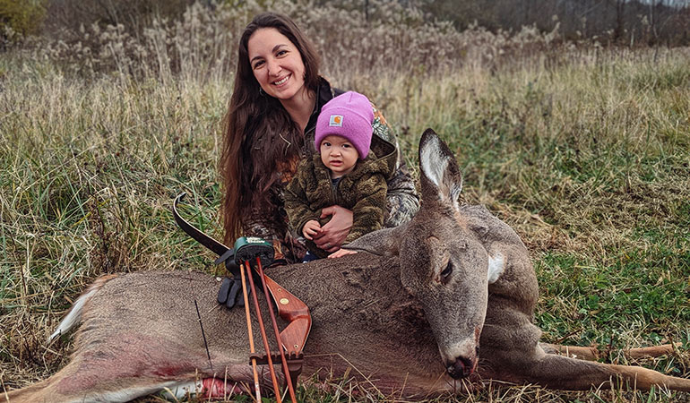 Young Mom Arrows Doe With Her Baby Daughter on Her Back