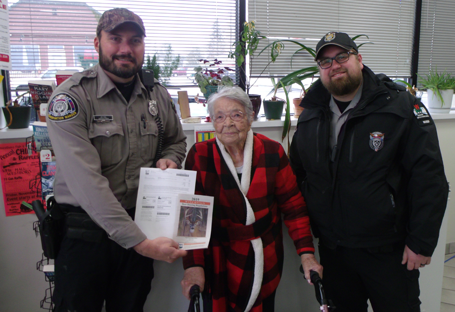 Florence Teeters with her first-ever hunting license. (Image: Bill Ball)