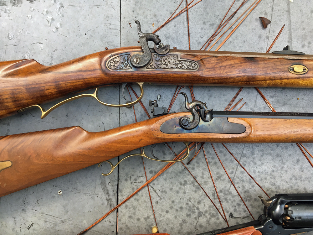 The two sidelock rifles are Phoenix (top) and the wonderfully light T/C Seneca. (Photo © Russ Chastain)