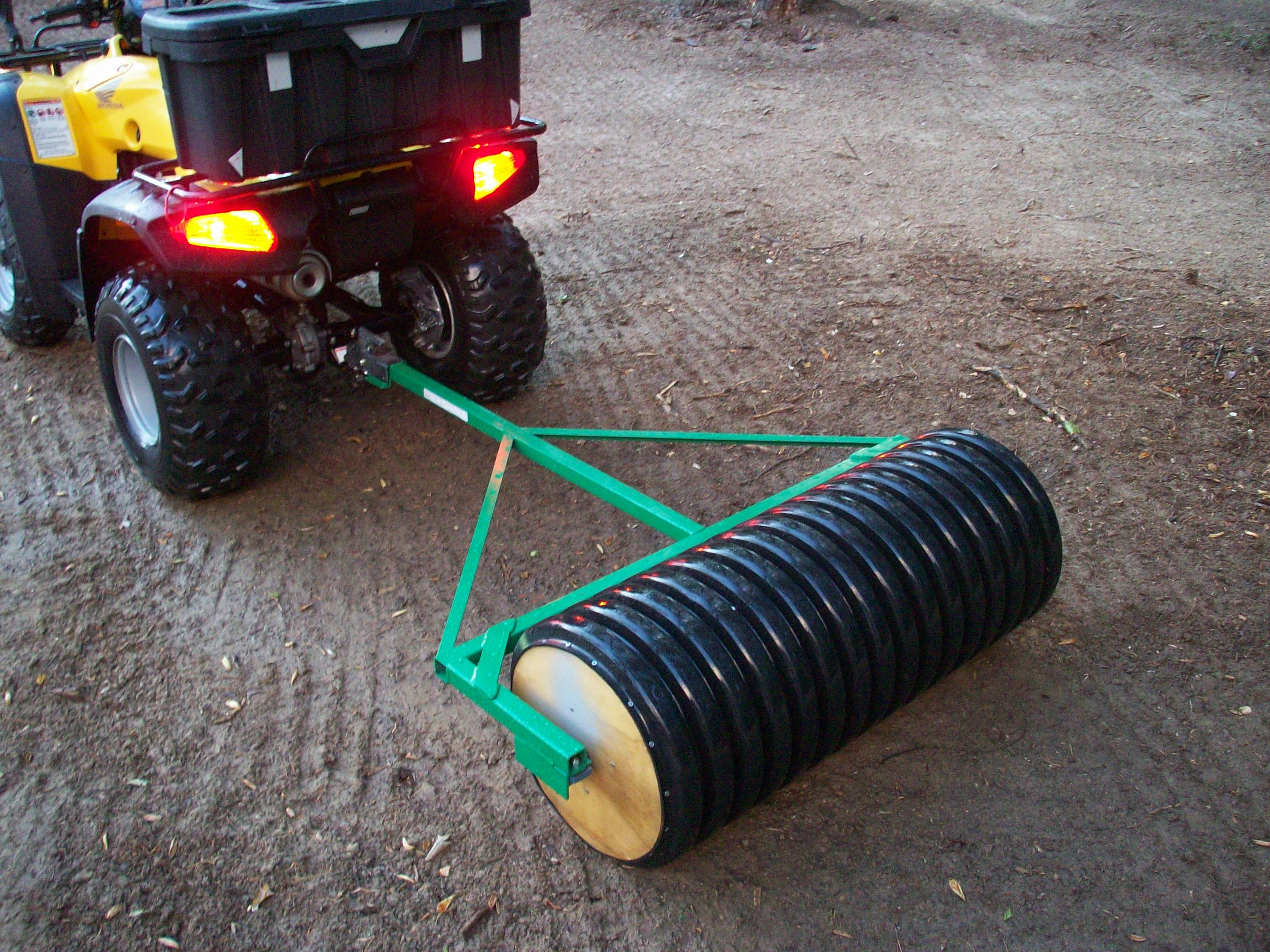 This homemade cultipacker is concrete-filled plastic drain pipe with a steel axle & bearings.